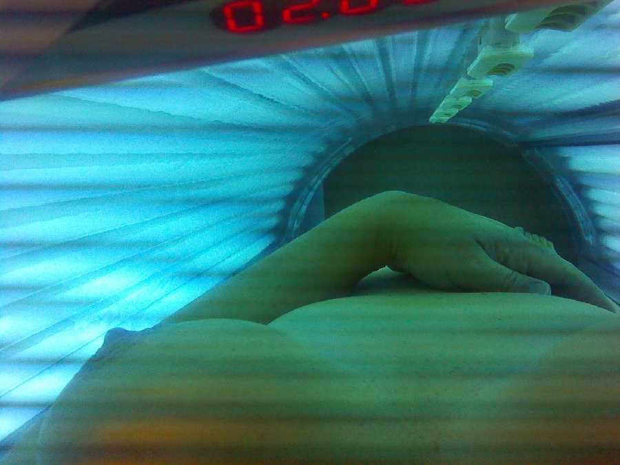 Nude in Tanning Bed