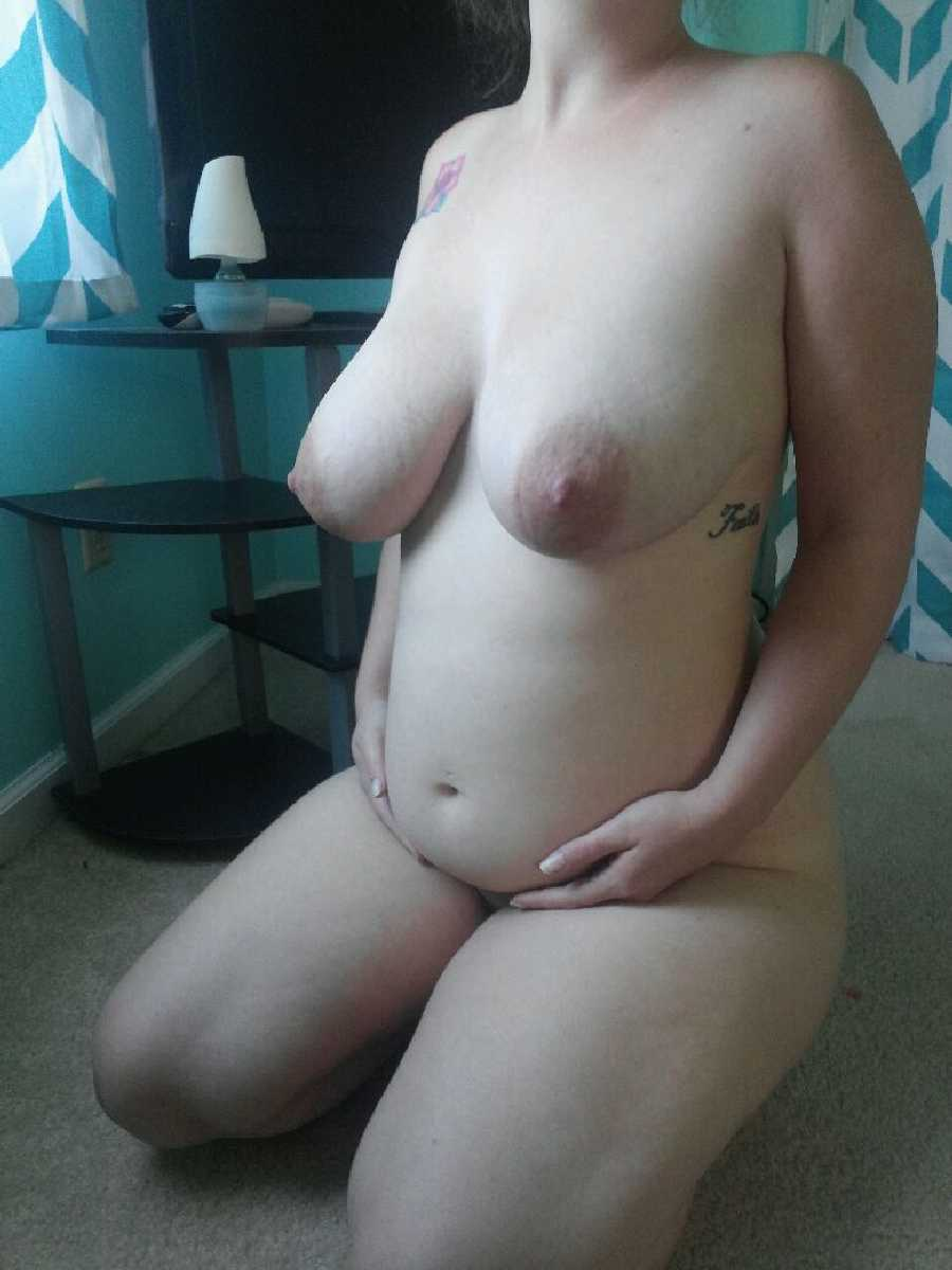 Nude with a Pregnant Belly
