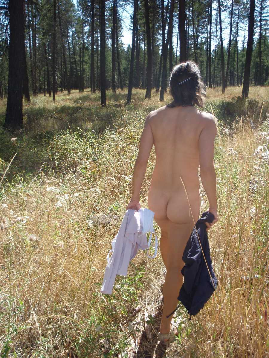 Nude wife out in the woods naked