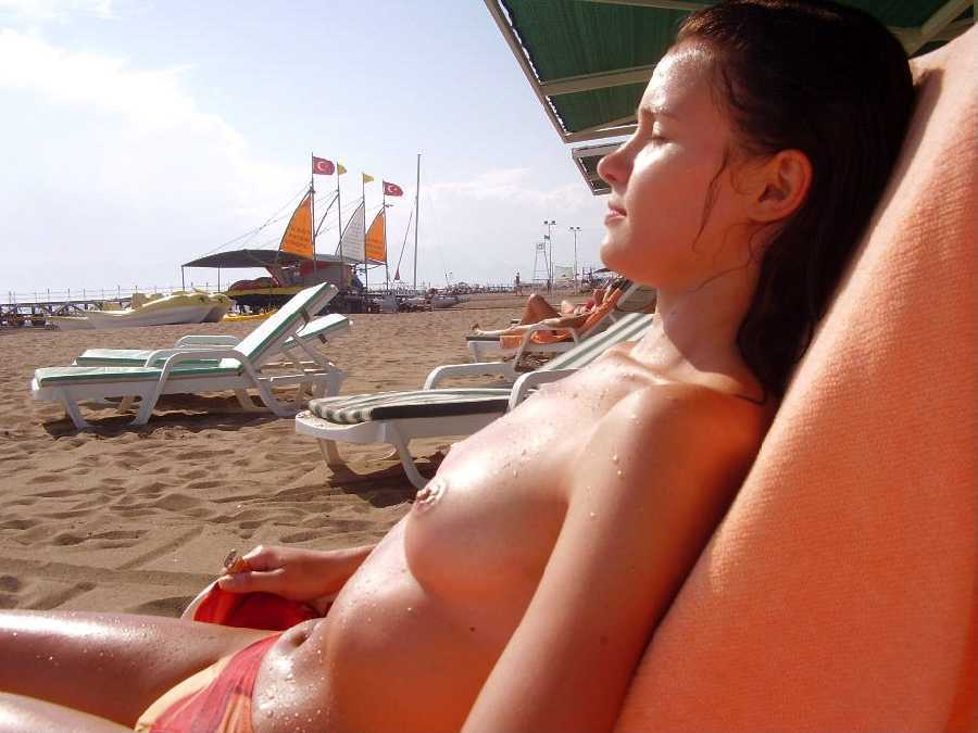 Topless girls tanning, black guy pool naked