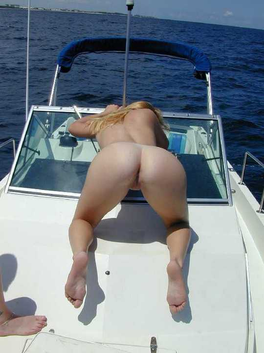 Naked girls boating