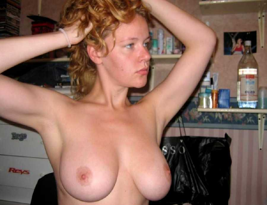 Horny wife shows off tits to others