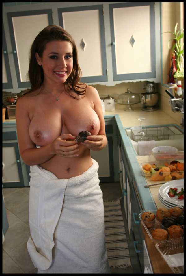 Nude wife in kitchen
