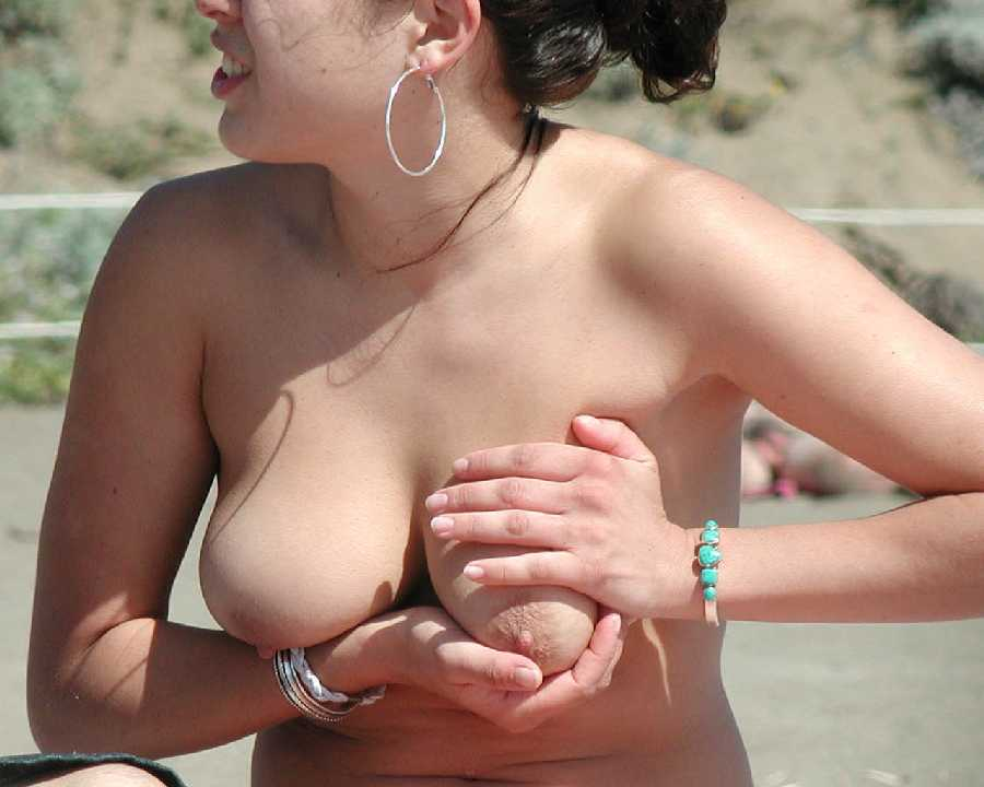 Girls naked breast at the beach