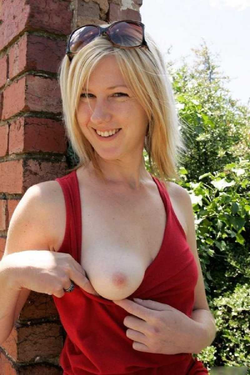Horny mature flashes one tit