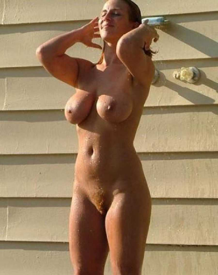 Woman shower in beach shower naked
