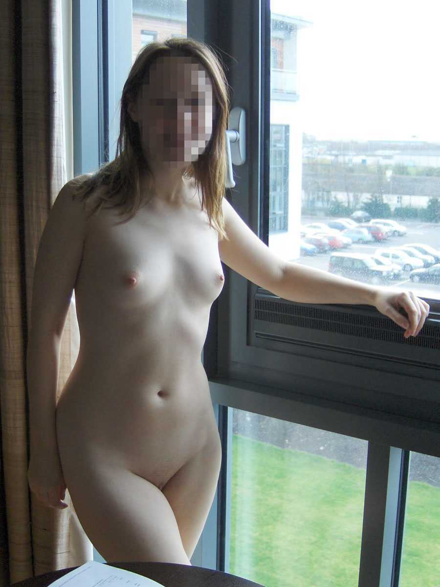 Naked pictures in front of open windows